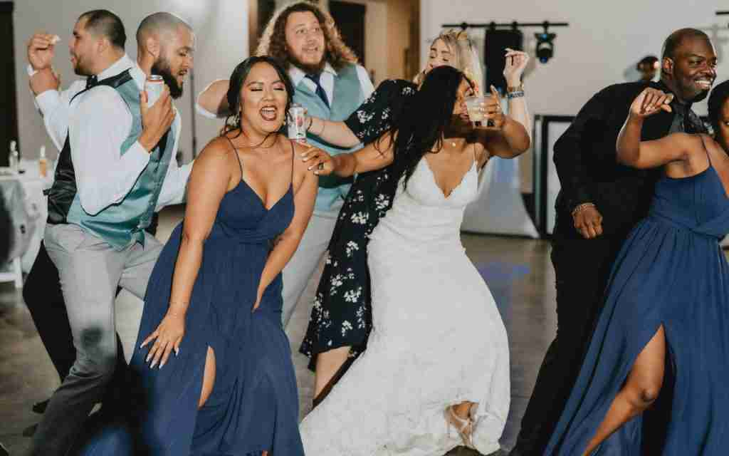 Bride-dancing-with-guests-during-her-wedding-reception