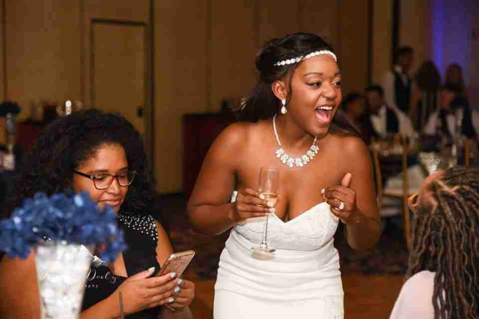 Ebony Having fun with family and guests at her Wedding Reception