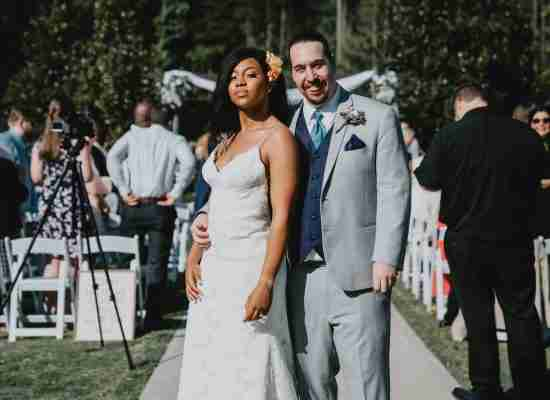 Kayla and Daniel pose after wedding ceremony at Sweet Magnolia Estate