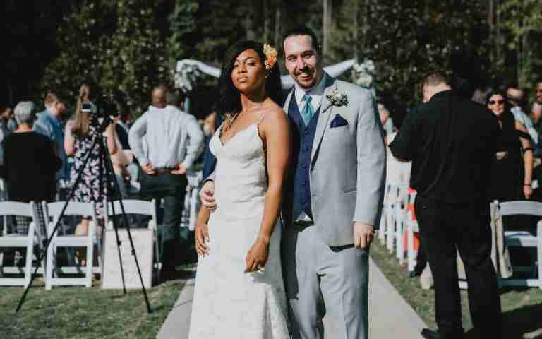 Kayla and Daniel pose after wedding ceremony at Sweet Magnolia Estate