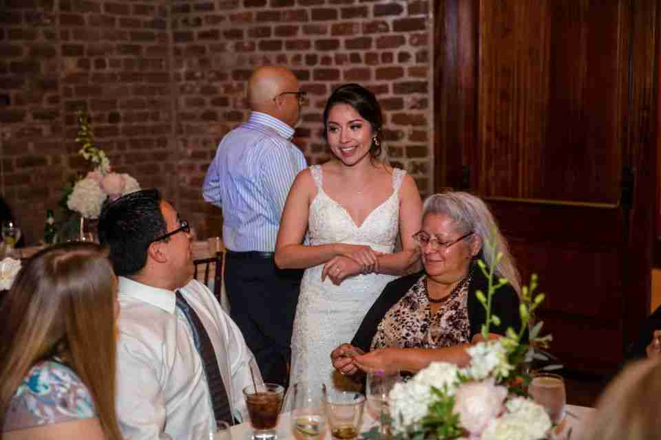 Nancy talking with family and guests during her Wedding Reception at Charles H Morris Center