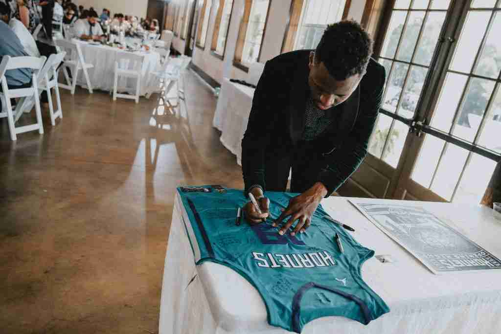 Charlotte Hornets Themed Wedding Ideas_Guest Signing Jersey