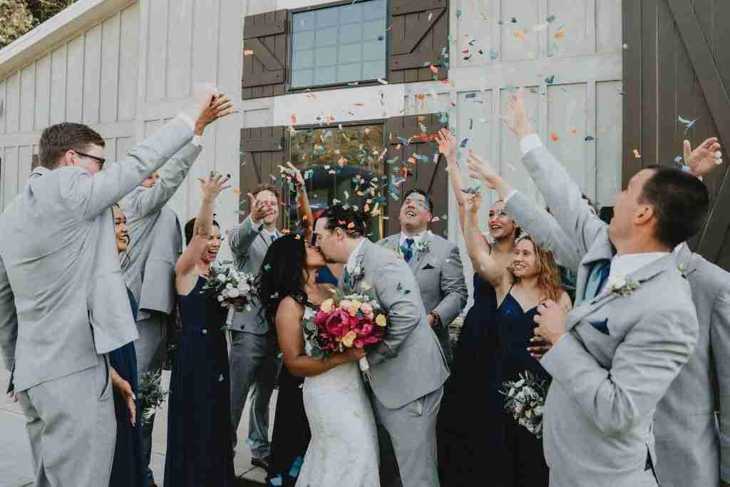 Charlotte Hornets Themed Wedding Ideas_Newlyweds Kiss_Confetti