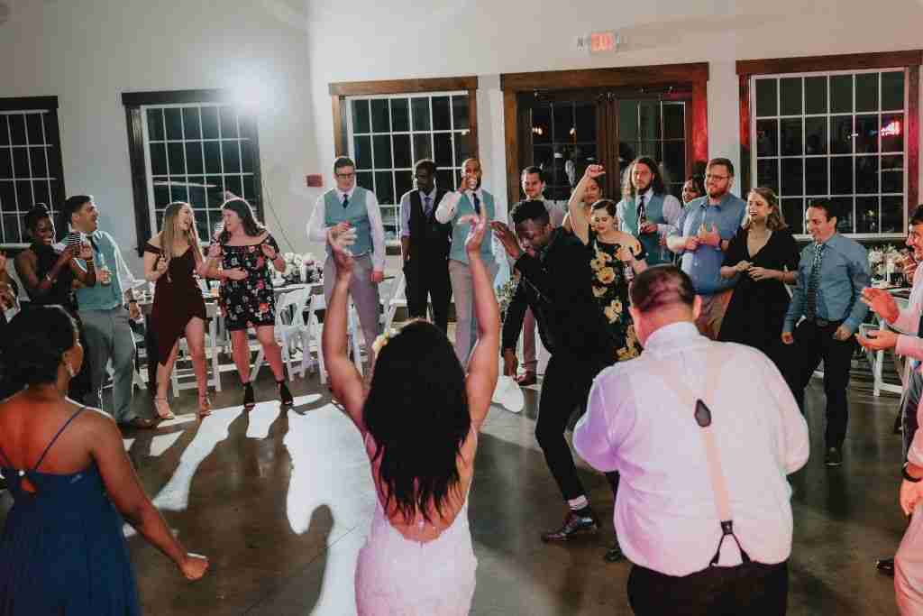 Charlotte Hornets Themed Wedding Reception_Bride forms dance circle with guests