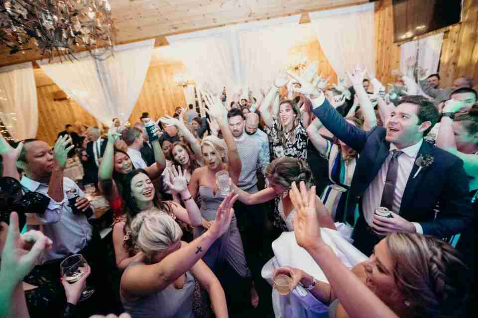 Bride surrounded by guests Dancing at her Wedding Reception
