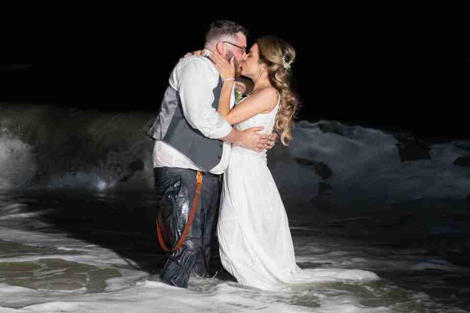 A Beautiful Beach Wedding on Hilton Head Island, SC 2021_Bride and Groom Kiss In The Ocean