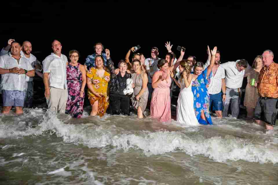 A Beautiful Beach Wedding on Hilton Head Island, SC_Bride, Groom and Guests In The Ocean_2