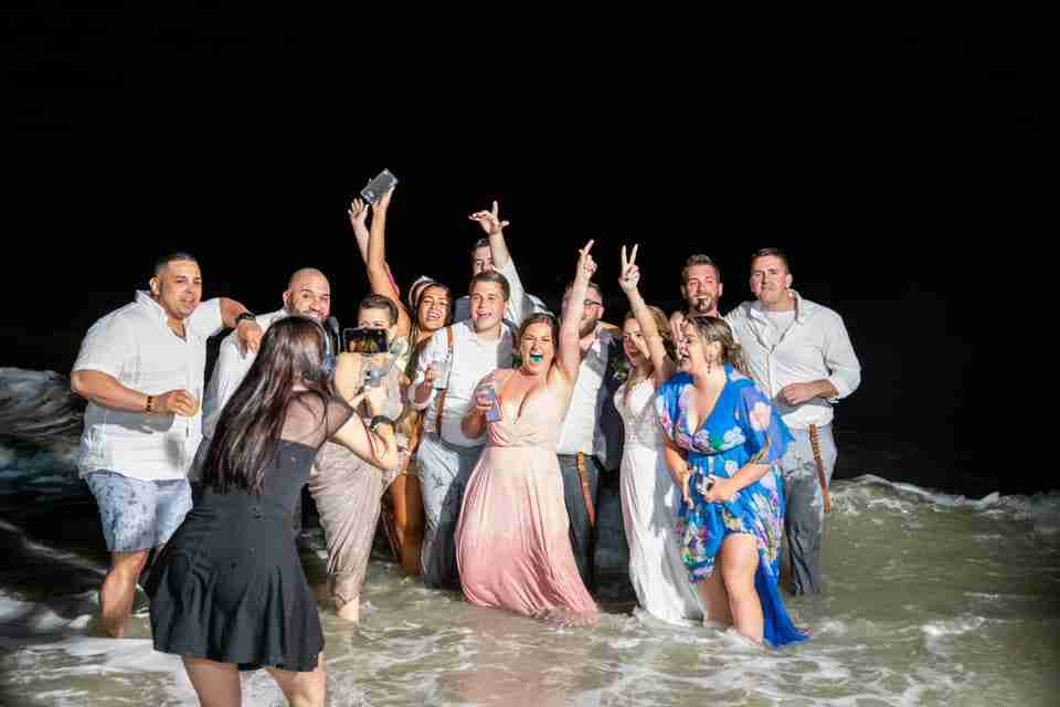A Beautiful Beach Wedding on Hilton Head Island, SC_Bride, Groom and Guests In The Ocean_3