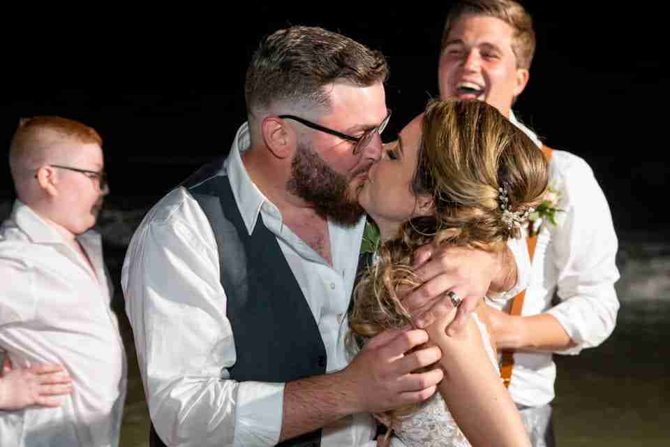 A Beautiful Beach Wedding on Hilton Head Island, SC_Bride and Groom Kiss In The Ocean