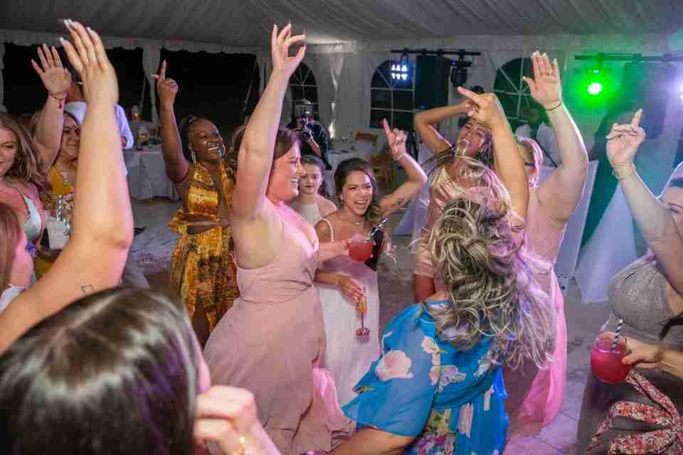 Wedding Reception Guests Dancing at Holiday Inn Resort Beach House_6